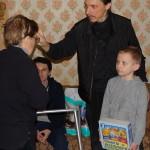 Братия Лавры навестили бабушку с сиротой и крестной дочерью-инвалидом